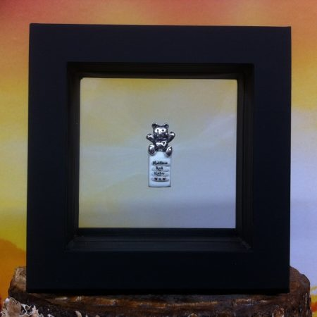 rice writing in frame - teddy charm