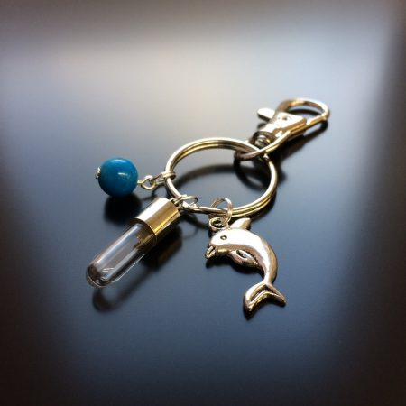 rice writing rice charm key ring with dolphin charm and turquoise howlite crystal